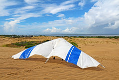 Hang glider on a sand dune at Jockeys Ridge State Park, Nags Hea. Hang glider on the sand of  Jockeys Ridge State Park in Nags Head on the Outer Banks of North Royalty Free Stock Photography