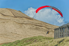 Hang Glider soar near Condo`s in Pacific City Stock Photos