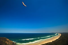Hang Glider Soaring over Beach Byron Bay Royalty Free Stock Photo
