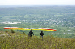 Hang gliders. Hang gliding; two male hang gliders on the edge of a cliff Stock Photo