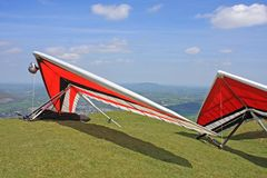 Hang Gliders. On a hill prepared to fly stock photos