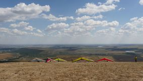 Hang gliders at launch on the hill stock video footage
