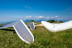 Hang gliders parked before taking a flight over the hills on a sunny day Stock Image