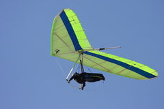 Hang gliding. A man hang gliding on a sunny day Royalty Free Stock Photo