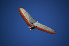 Hang gliding. Tandem hang gliding on a blue sky Stock Photo