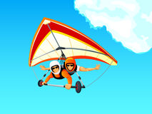 Hang gliding. Cheerful hang gliding tandem flying in sky Stock Image