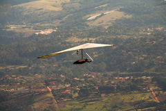 Hang gliding. With city on background Royalty Free Stock Photo