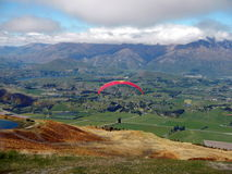 Hang gliding. From Coronet Peak over the valley not far from Queenstown South Island New Zealand Royalty Free Stock Photos