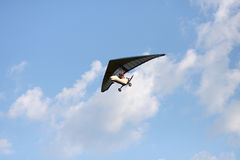 Hang gliding is flying in the sky. Hang gliding is flying in the blue sky Royalty Free Stock Photo