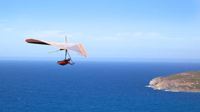 Hang Gliding. A hang glider flies off Shelley Beach in West Cape Howe National Park, near the towns of Albany and Denmark in Western Australia royalty free stock images