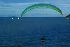 Hang gliding. Hang Glider souring off the coast of  Queensland,Australia Stock Image