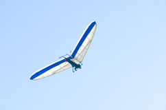 Hang gliding. A man hang gliding high in the air Royalty Free Stock Images