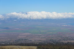 Hang Gliding at Maui Hawaii. A hang glider out over the tropical island of Maui Hawaii Stock Image