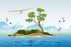 Hang gliding over the island Stock Image