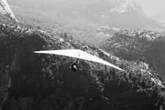 Hang-gliding over a valley Royalty Free Stock Image