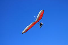 Hang Gliding Piolot soars on wings as Eagle Stock Image