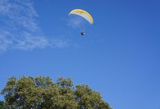 Hang gliding in the sky. Flying in the blue sky glider Royalty Free Stock Image