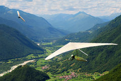 Hang gliding in Slovenia. Slovenian Open Championship. Two gliders and beautiful mountains Stock Image