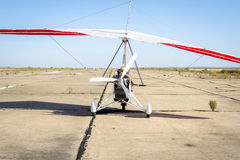 Hang-gliding, standing at dawn on the runway Stock Image