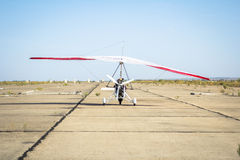 Hang-gliding, standing at dawn on the runway Stock Photos