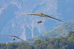 Hang gliding in Swiss Alps royalty free stock image