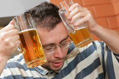 Hang-over. Man to have a hang-over in a pub stock photo