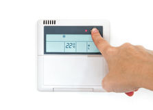 Hang selecting home temperature on control panel Stock Image