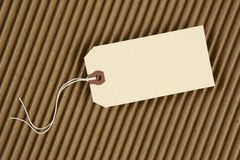 Hang tag. Blank hang tag with space for copy shot on corrugated cardboard Royalty Free Stock Images