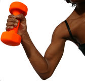 Hang on tight. African American woman holding out a orange dumbell on white background stock photography