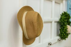 Hang Your Hat woven straw hat hanging on a wall rack Royalty Free Stock Photos
