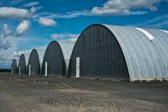 Hangar in aerodrome. Vintage metalic hangars in aerodrome stock photos