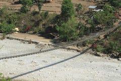 Hangbrug in Nepal Stock Foto