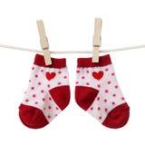 Hanged baby socks Stock Image