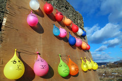 Hanged baloons. Baloons hanged from a wall with vivid sky on the backgound royalty free stock image