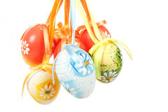 Hanged bright color easter eggs with bows Royalty Free Stock Photo