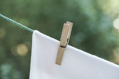 Hanged clean and wet cloth at garden. In order to dry Stock Photos