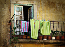 Hanged Clothes. Old house and balcony with hanged clothes Stock Image