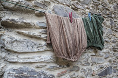 Hanged clothes against wall Stock Photography