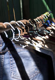 Hanged clothes in house. Close up of hanged clothes Stock Photo