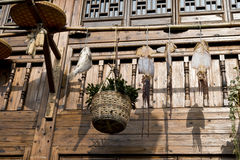 Hanged fishes and basket. Hang hanged fishes and basket before a chinese traditional wooden building Royalty Free Stock Photo