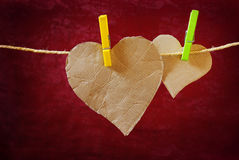 Hanged Heart. Heart-shaped cardboard pieces hanged in a rope with pins Royalty Free Stock Image