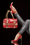 Hanged on heel. Stylish red bag hanging on a chic high-heeled shoe Royalty Free Stock Photos