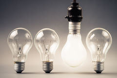 Hanged light bulb Royalty Free Stock Photos