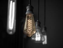 Hanged light bulbs in dark room color-splash tone Royalty Free Stock Photo