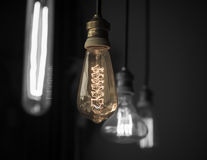 Hanged light bulbs split tone color with black and white Royalty Free Stock Image