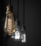 Hanged light bulbs split tone color with black and white Stock Images