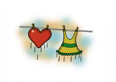 Hanged Love. A wet heart is hanged to dry Stock Image