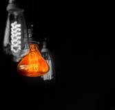 Hanged  orange decoration light bulbs split tone  color with bla Royalty Free Stock Photography