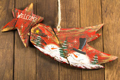 Hanged red wooden decoration comet star Royalty Free Stock Images