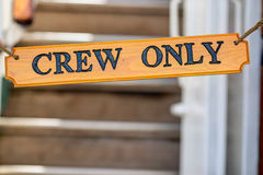 Hanged sign `Crew Only` on the stairs Royalty Free Stock Images